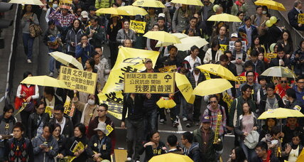 Umbrellas aloft, thousands march for democracy in Hong Kong