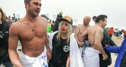 Lady Gaga jumps into a lake: Charitable giving or celeb self-promotion? (+video)