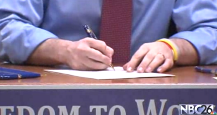 Wisconsin Governor Walker signs bill that incenses organized labor