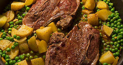 Braised lamb chops with potatoes, peas, and cumin