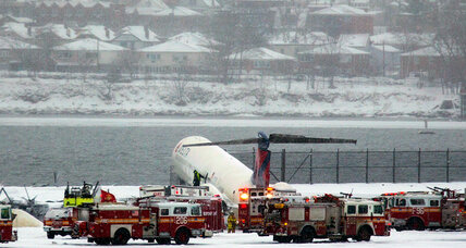 Plane skids off LaGuardia runway landing with its nose close to edge of icy bay (+video)
