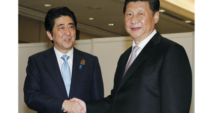 Japan's Abe and China's Xi meet, agree to work for better relations