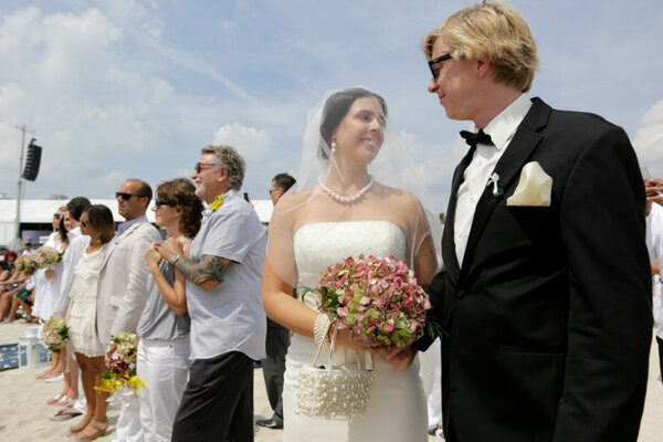 Of A Group Wedding And Vow Renewal Ceremony In March Miami Beach Fla Some Engaged Couples Are Asking Friends Families To Donate Charities