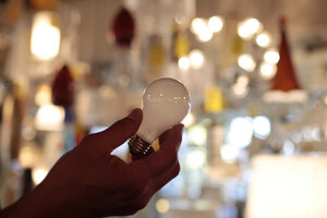 Manager Nick Reynoza Holds A 100 Watt Incandescent Light Bulb At Royal  Lighting In Los Angeles. Energy Star Qualified CLF And LED Bulbs Might Cost  A Little ...
