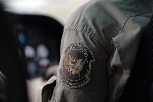 a us customs and border protection air and marine agents patch is seen as he patrols patrol near the texas mexico border feb 24 in rio grande city