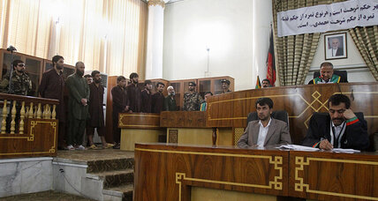 Afghan judge sentences 4 to death for killing woman