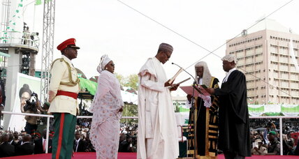 With doves and a broom, Buhari promises change to Nigerians