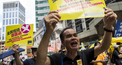 Hong Kong activists march ahead of vote on electoral package