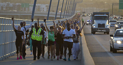Charleston residents come together on bridge to promote peace and unity (+video)