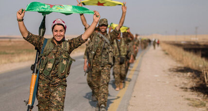 Syrian Kurds take town, base near Islamic State stronghold