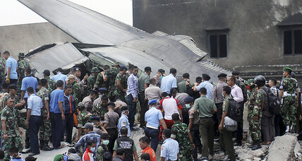Military plane crashes in Indonesia's 3rd largest city, killing at least 55