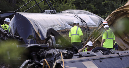 Rear-end train collision sends 20,000 gallons of lube oil seeping onto ground