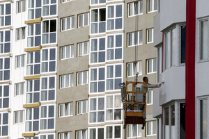 A Worker Paints The Wall Of A Newly Constructed Apartment Building At A  Construction Site In Kiev, Ukraine, July 15, 2015. When You Walk Into Your  New ...