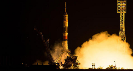 Despite glitch, Soyuz crew safely docks with space station