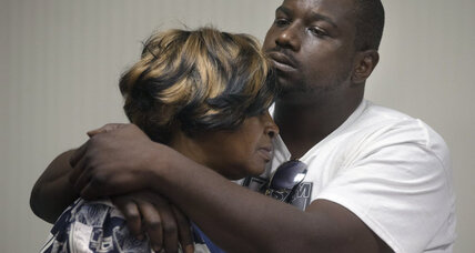 Family of black man killed during traffic stop urges calm