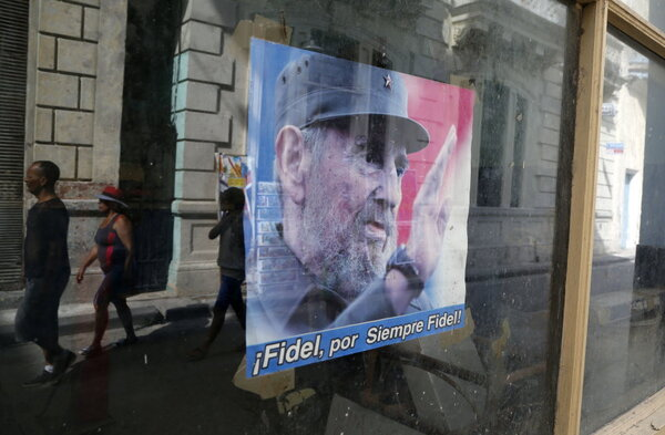 fidel castro to obama you owe us millions com a poster of fidel castro a message that reads in spanish fidel forever fidel decorates the administrative office window of state run food stores