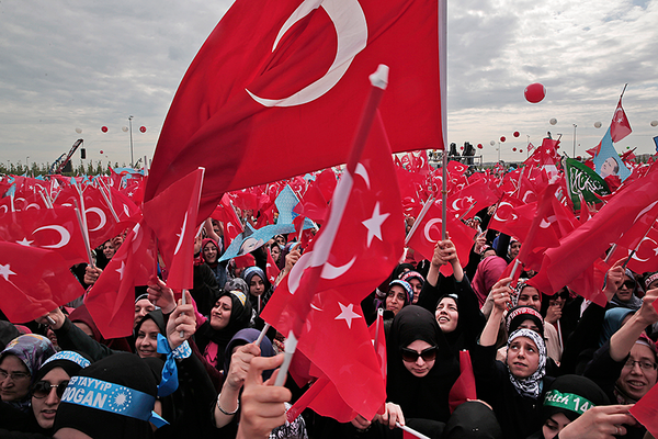 Supporters Of Turkeys President Recep Tayyip Erdogan Sing And Wave Turkish Flags As They Wait For Their Appearance In Istanbul On May