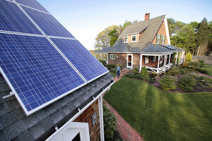 A Resident Walks From His House To His Garage Where His Solar Energy Panels  Are Mounted On The Roof In Marshfield, Mass.