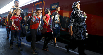 Migrants reach Austria by train, while EU tries to deal with asylum rules