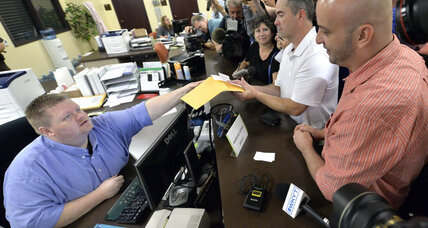 Rowan County couples receive marriage licenses, jailed clerk denies validity