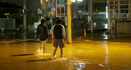 Flooding in Japan forces dozens of residents to rooftops, await rescue
