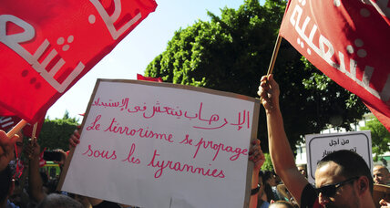 Tunisians march against corruption amnesty law