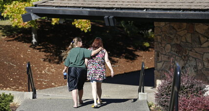 Oregon college shaken by massacre reopens with counselors, comfort dogs