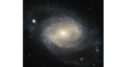 Spectacular Hubble photo: A bright galaxy holds a hidden secret