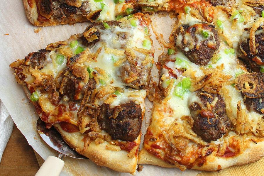 Sauerkraut and meatball pizza