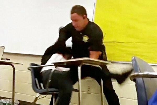 This Photo Made From Video Taken By A Spring Valley High School Student On Monday Shows Senior Deputy Ben Fields Trying To Forcibly Remove
