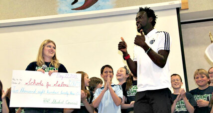 Soccer star goes home to build schools