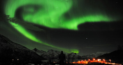 Why does an aurora have bursts of brightness?