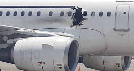 Somalia says bomb blew hole in passenger jet. Is Al-Shabab responsible?