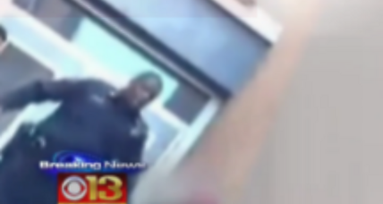 Baltimore school police officer seen kicking student on video