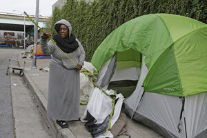 Angela Flax packs up her tent at an enc&ment along Division Street Friday Feb. 26 2016 in San Francisco. Homeless people have until the end of Friday ... & Denver to evict homeless from makeshift camps - CSMonitor.com