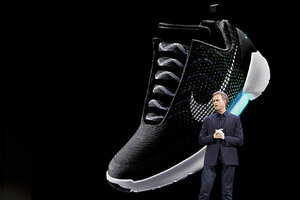 An image of the Nike HyperAdapt 1.0 is projected on a screen as Nike CEO  Mark Parker speaks during a news conference on Wednesday in New York.