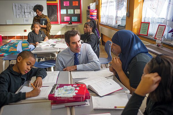 Scott Gordon, CEO of Mastery Charter Schools, chats with students during a  tour of Frederick Douglass Middle School, which the charter operator took  over in ...