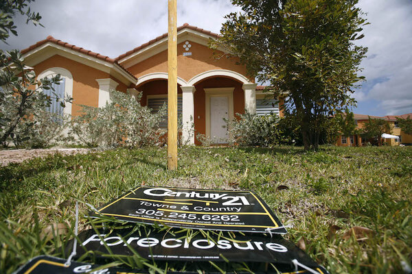A For Sale Sign Lays On The Ground In Front Of A Foreclosed Home In Homestead Fla