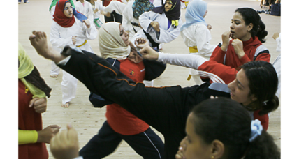 In teaching self-defense, a taekwondo champ builds young women's confidence