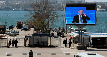 A kinder, gentler Putin? President speaks softly on Russian call-in show