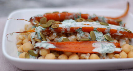 Chickpeas flavored with farro and topped with oven-roasted carrots