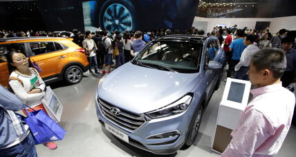 China mulls cutting its electric car production quota