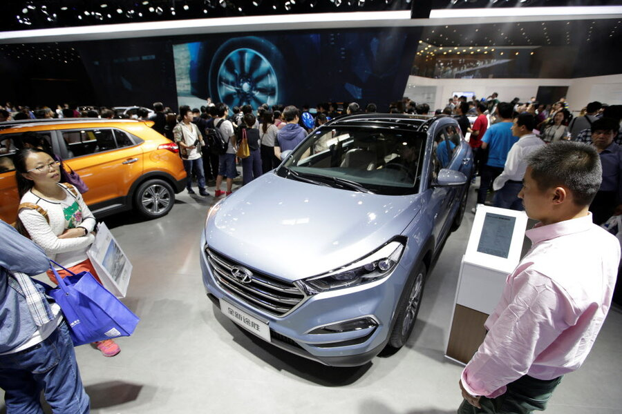 Car Expo Standsaur : China mulls cutting its electric car production quota