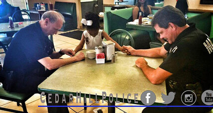 Little girl leads police officers in prayer
