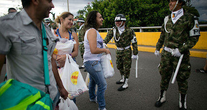 To ease food shortages, Venezuela opens border with Colombia