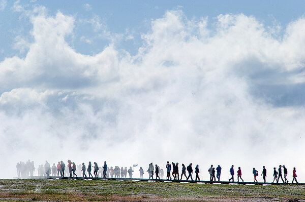 Yellowstone and beyond are the national parks being loved to death tourists stroll on a boardwalk through the rising steam of grand prismatic spring at yellowstone national park publicscrutiny Image collections