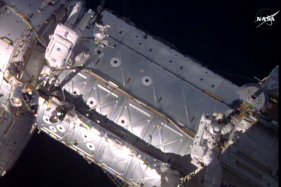 Space station's new door swings open to welcome commercial