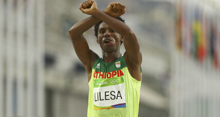 Ethiopia says marathoner, who fears for his life, to be welcomed as hero
