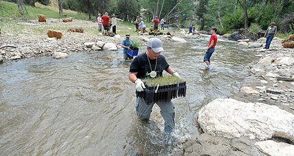 Three years after damaging Colo. flood, teens help with river restoration