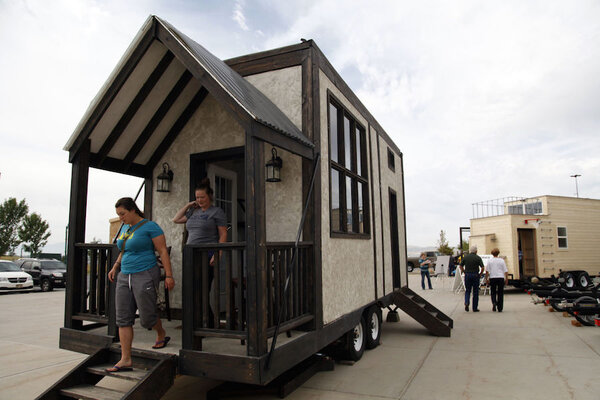 brynna brockback left and leslie kay right exit a model tiny house at a display outside the cabelas in lehi utah the tiny home movement is a